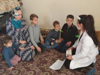 Syrian refugee family receiving personal protective equipment and covid-19 training in Mardin, Turkey