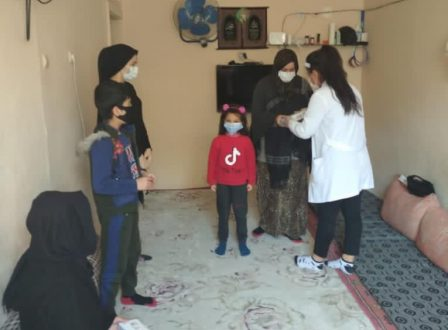 Syrian refugee family receiving humanitarian aid